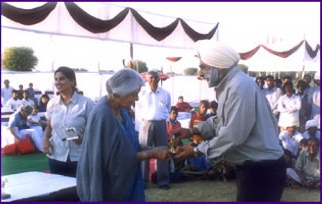 Colonel K. S. Garcha President of the Jaipur Polo & Riding Club presenting a trophy to Her Highness Rajmata Gayatri Devi