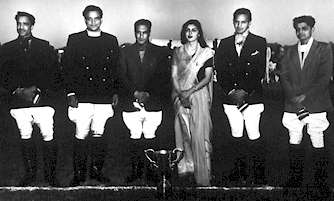 Her Highness Maharani Gayatri Devi and His Highness Maharaja Man Singh with the Jaipur Polo team.