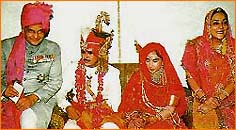 A family picture at the wedding of the Maharaj Kumari.  (left to right) The Maharaja Sawai Bhawani Singh, Narendra Singh Rajawat, Maharaj Kumari Diya Kumari, Maharani Padmini Devi.