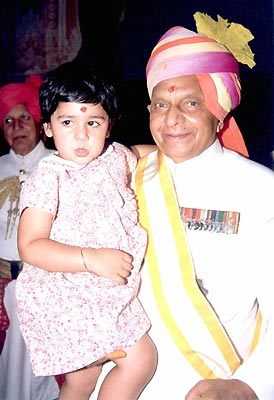 His Higness Maharaja Brigadier Sawai Bhawani Singh with his grand daughter. She is the daughter of Princess Diya Kumari and Kumar Narendra Singh.
