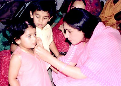 Princess Diya Kumari with her daughter. Her son, Yuvraj Shri Padmanabh Singh, stands behind his baby sister.